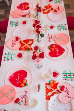 Take a look at the amazing table settings with heart-shaped plates at this cherry-themed Valentine's Day party! See more party ideas and share yours at CatchMyParty.com #catchmyparty #partyideas #4favoritepartiesoftheweek #tablesettings #cherries #valentinesday #valentinesdayparty