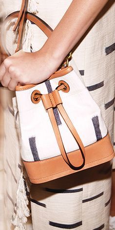 A mini-bucket bag in a linear print inspired by a blanket of Tory's #toryburch #toryburchspring15  #nyfw