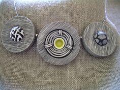 Angela Garrod. Polymer Clay scraffitto necklace.  Each disk is a hollow box