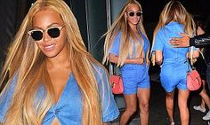 373be316573 Beyonce parades her toned legs in a plunging denim jumpsuit