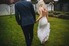 Bride wears a backless feathered Enzoani wedding dress. Images by Martin Makowski Photography #backlessweddingdress #enzoani #weddingdress #weddinggown #bridalgown #bridaldesigner #weddingfashion #weddingstyle #featherweddingdress