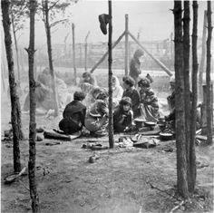 Bergen Belsen, Germany, Survivors sitting together, after the liberation, April 1945.