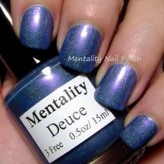 Mentality Nail Polish - Deuce, a gray blue holographic polish with highlights that travel from purple to red. Dries to a semi gloss finish. Great for stamping.
