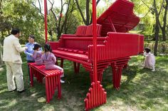 An installation called 'Red Piano' made of radiator tubing by Chinese artist Tian Ye displayed at the Art Beijing expo in Beijing