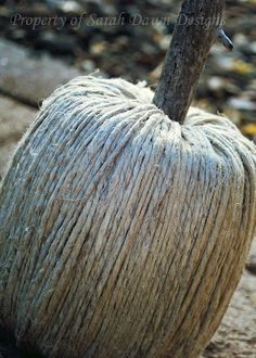 DIY Fall Shabby Pumpkin - made using twine, one roll of toilet paper, hot glue and a stick. Seriously? Love.