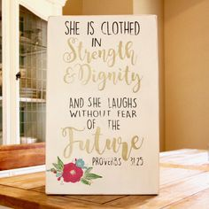She is Clothed in Strength and Dignity and Laughs Without Fear of the Future Proverbs 31:25 Hand Painted Wood Sign / Proverbs 31 Woman / Bible Verse Wall Art / Scripture Wall Art. She is Clothed in Strength and Dignity Proverbs 31:25 Hand Painted Wood Sign / Proverbs 31 Woman / Bible Verse Wall Art / Fixer Upper Decor / Scripture Wall Decor / Rustic Wood Sign / Mother's Day / Valentine's Day / Birthday Gift / Farmhouse Style / Reclaimed Wood / Scripture Wall Art - Hand Painted Wood Sign -...