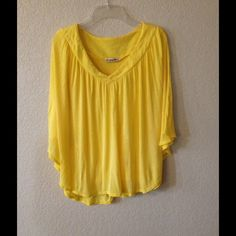 Poncho Top - Canary Yellow Unique poncho top. Light stretchy fabric, tank top underlay. Never been worn. Tops
