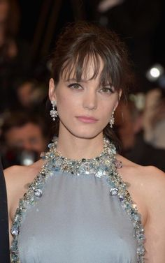 Stacy Martin wearing High Jewellery diamond earrings by Chopard at the premiere of Redoubtable at the Cannes Film Festival