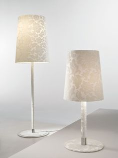 Ever popular, a lovely cream damask fabric covers these lovely lamps, perfect for your bedside, as they're tall enough for you to read by. You can find out more at:  http://www.italian-lighting-centre.co.uk/wood-leather-fabric-organic/light-damasco-white-damask-table-lamp-p-7808.html#.VUJxcPnF9j8
