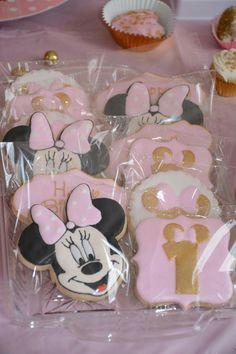 Pink and gold minnie mouse 1st birthday cookies.