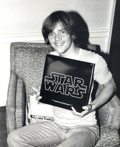 Mark Hamill with the Star Wars Original Motion Picture Soundtrack.  My parents had this same LP until about 5 years ago.  They sold it to Half Price Books.  I cried when I found out.  Nooooooooooooooooooooooooooooooooooooooooooo!