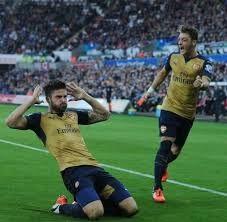 Ozil Celebrates with Olivier Giroud