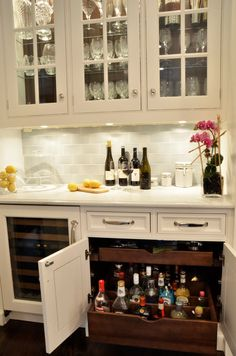: Wonderful White Themed Traditional Kitchen With White Wooden Liquor Cabinet And Island Installed On Wooden Floor