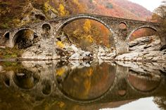 © nrqemi/Getty Images. Dyavolski Most (Devil's Bridge), Ardino, Bulgaria. Built in the early 16th century, this gracefully arched bridge is said to be marked by the devil's footprint.