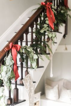 Cascading garland and ribbon wrapped banister: http://www.stylemepretty.com/living/2016/12/22/a-magical-holiday-home-tour-with-a-strong-mantel-game/ Photography: Ruth Eileen - http://rutheileenphotography.com/
