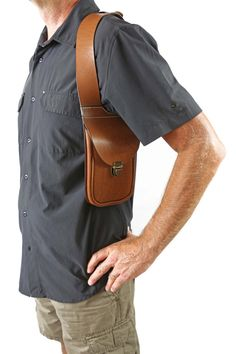 Bag shoulder holster -  -Material : Leather vegetable tanning.  -Fabrication : Made entirely by hand , Created from a molded piece of leather .