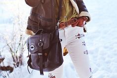 Really creative way to style aztec print white jeans: with a brown leather jacket & olive green shirt