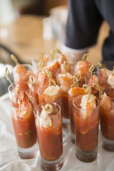 Shooters of chilled gazpacho soup with fresh lobster skewers. Upscale catering for corporate events, fundraisers, social events and millennium weddings.