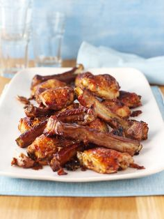 MAPLE CHICKEN 'N' RIBS by Nigella Lawson. This recipe says it all. You need no more than a few minutes to load up a couple of freezer bags with ribs and chicken, oils and unguents and then, after a day or so's untroublesome marinating in the fridge, you tip out the contents into a roasting tray and slot it in the oven. Your input is minimal, but what you get out is a big feast that feels homey and welcoming and makes everyone happy, you included…