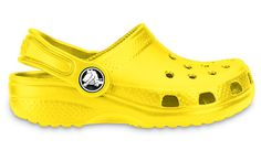 Crocs™. The only way to travel in the summertime. Kids can put them on,  they wipe clean, and they dry in the sun.