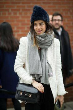 Leandra Medine tops off her look with a fuzzy hat in New York City.