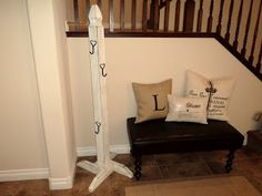 Fence post + 2x4 + hooks = stocking tree. This would be a great solution to the mantle holders that can't handle the weight after the stockings are filled on Christmas Eve. The rest of the year.... I'm thinking, tuck the post in a closet for purse storage :)