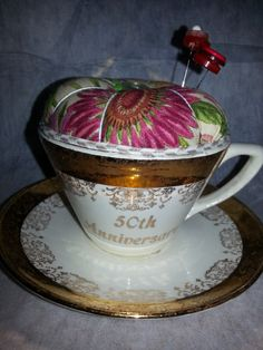 Pincushion in a vintage cup and saucer https://www.etsy.com/listing/167935844/pincushion-in-a-lovely-vintage-china-cup