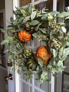 Shades of Fall. This autumn wreath, color on color, has two perennial orangey pumpkins. The remaining wreath is color on color - not busy - sage