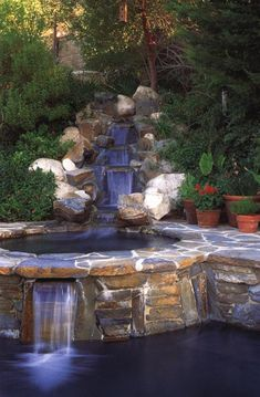 Fine rockwork and good design make this an extraordinary swimming pool, combining a series of waterfalls and several discrete bathing areas with pretty terracing and lush garden plantings. How much nicer than a simple, flat, featureless in-ground pool. The superb construction here in the Moss family garden in Saugus, California, integrates pool, garden, and patio into one overall scene, and the sound of the falling water blocks any street noise that might reach this idyllic spot.