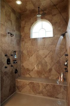 Shower with dual shower heads, a rain shower head, a bench and cubbies for shampoo. Very nice! but must be a walk in shower.no doors, I HATE CLEANING DOORS! Dream Bathrooms, Beautiful Bathrooms, Tile Bathrooms, Chic Bathrooms, Bathroom Vanities, Master Shower, Master Bathroom, Roman Bathroom, Attic Bathroom
