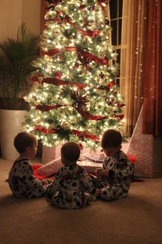 All lights off except tree, use a tripod, ISO 6400, shutter speed 1/30, Tv mode. I am NOT a good photographer and I can never get my boys to smile at the same time so I just turned their backs to the camera to get a good Christmas shot.