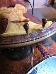 Hand sewing cantle binding