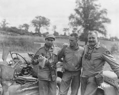 Robert Capa on left on the road to Paris, August 1944, with Ernest Hemingway on the right.