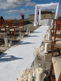 Gazebo, white and pale pink rose petals and glass cylinders with candles.  Event Planner : Wedding Italy.