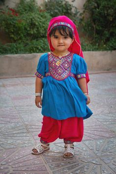 An Afghan girl dressed in traditional clothing. By Morteza Herati.To see more of Morteza's photography, visit and like Afghan Street Photography