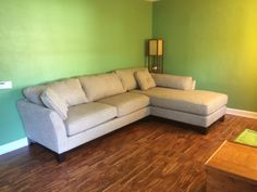 Living room pre-decoration. Green walls. Barley sectional couch with chaise from La-z-boy.