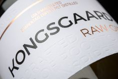Kongsgaard Gin Raw Gin Label designed by Bettina Kongsgaard and proudly printed by Multi-Color UK. Visit www.mccshowcase.co.uk/ for more beautiful labels.