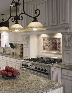 Love the scrolls on the sides of the stove, the amazing mural back splash art, and the lighting.