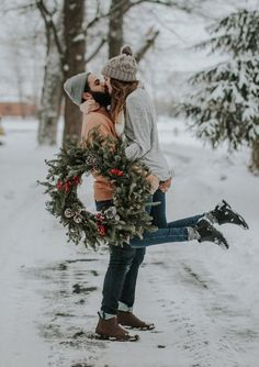 Add some casual fun to your holiday engagement session with cute his-and-her knit hats! If their hats won't keep them warm enough, their love certainly will. | Outfits for a Winter Engagement Session