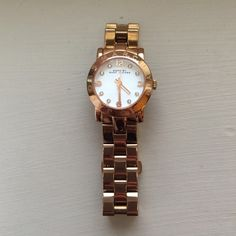 Women's Marc Jacobs Watch Mini Amy Bracelet 26 MM in ROSE GOLD.  Minor scratches on bottom of band. Fits my tiny wrist but comes with the extra pieces to fit your wrist! Very unique color and beautiful piece. Comes with: Box, Care booklet, Extra band pieces, and Pillow for it to sit on. Marc by Marc Jacobs Accessories Watches