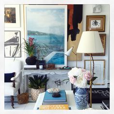 Gallery wall filled with favorite items. By William McLure
