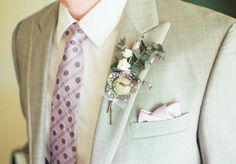 Lilac and white boutonniere with purple tie