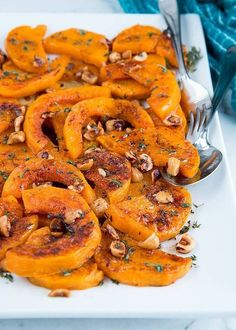 roasted butternut squash with hazelnut brown butter sauce and thyme.