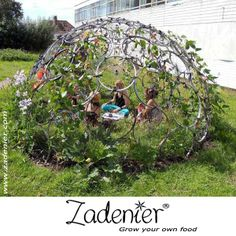 This building is made from old #bicycle wheels. When #bean plants growing over it, a green house created. A great idea to get a great bean harvest and a nice place for kids to play in.  www.zadenier.com