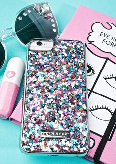 Skinnydip Ely Glitter iPhone Case get yer glow on, babe. This phone case features a silver construction that snaps snugly onto yer phone and has a super cute multicolored glittery back so yew stay shinin' no matter what.