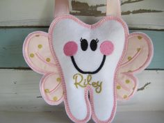 How sweet is this personalized Tooth Fairy Pillow? We love how you can personalize this pillow and can't get over how cute this tooth is.
