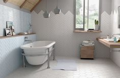 Cute bathroom setup using our Dunas tiles and hexagons on the floors. Shop the look: https://www.nationaltiles.com.au/products/products-tiles/shopby/range-dunas