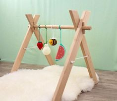 Wooden baby gym with 4 crochet toys, activity center, play gym, nursery decor, baby rattles, shower newborn gift, hanging toys, Montessori  WORLDWIDE SHIPPING --------------------------------------------------------------------------------------------------------- Our wooden activity center with four crochet hanging rattles is a must have for new parents because it is great for babies to play and stimulate development of their visual and motor skills. Your baby will get so much joy from the…