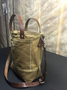 : Heavy Waxed Canvas # 10 Duck 19.84 oz with double layered bottom for added strength : English Bridle Leather Leather Straps. There is an adjustable strap that can be detach from the bag. Adjustable up to 48. : English bridle 8/10-ounce Leather Straps. The straps are beveled and the