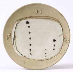 Lucio Fontana 1899 - 1968 CONCETTO SPAZIALE SIGNED AND DATED 57, PAINTED CERAMIC, HOLES AND GRAFFITO. THIS WORK IS REGISTERED IN THE FONDAZIONE LUCIO FONTANA, MILANO, UNDER N. 113/4 AND IT IS ACCOMPANIED BY A PHOTO-CERTIFICATE ISSUED BY THE FONDAZIONE LUCIO FONTANA, MILANO AND IT IS ACCOMPANIED BY A PHOTO-CERTIFICATE SIGNED BY THE ARTIST. firmato e datato 57 ceramica dipinta, buchi e graffito diametro cm 31,5